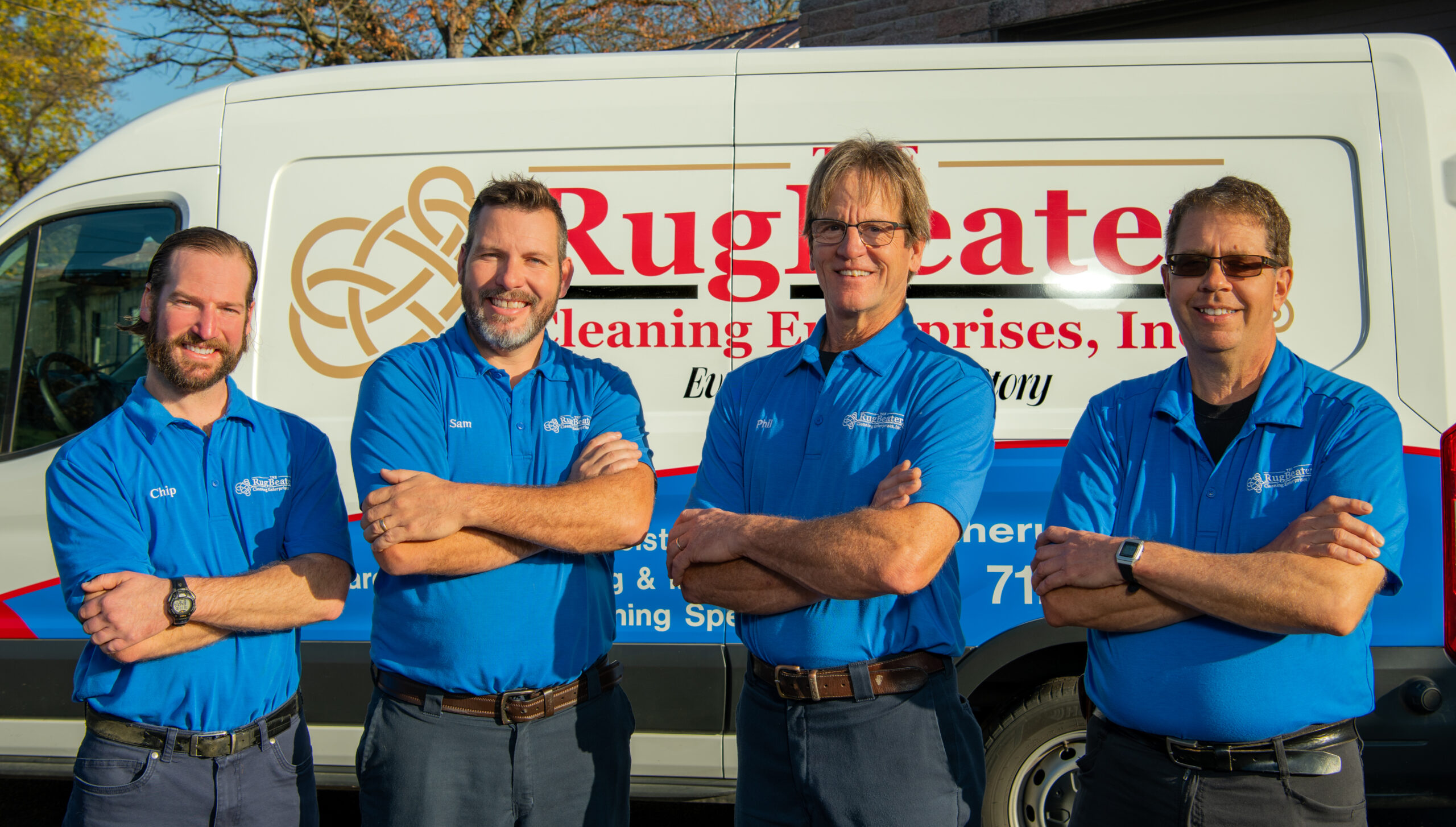 the rug beater team and van